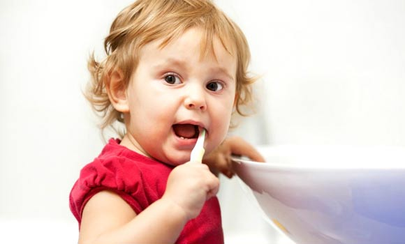 You should brush your child's teeth two times per day with fluoride toothpaste.